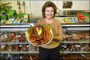 SLUG: FD/GTG. DATE: December, 26, 2007 CREDIT: Katherine Frey / TWP. LOCATION: Rockville, MD. SUMMARY: Kielbasa Factory, 1073 Rockville Pike with owner Krystyna Ahrens, who was born in Poland. CAPTION: Krystyna Ahrens opened the Kielbasa Factory on Rockville Pike on November 24, 2007. Kielbasa is the Polish word for sausage. On the platter, along with a small smoked ham are Kiszka, Kabanos, Swojska, Mysliwska and Wiejska kielbasas. StaffPhoto imported to Merlin on Wed Dec 26 16:35:03 2007